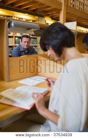 Man sitting at study desk in library