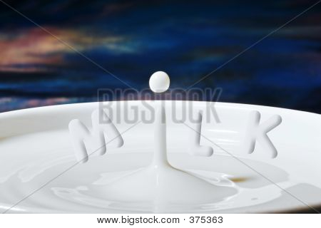 Milk Drop Or Droplet Dripping Into A Bowl Full With Letters Added To Makemilk