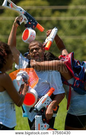 People Squirt One Another In Group Water Gun Fight