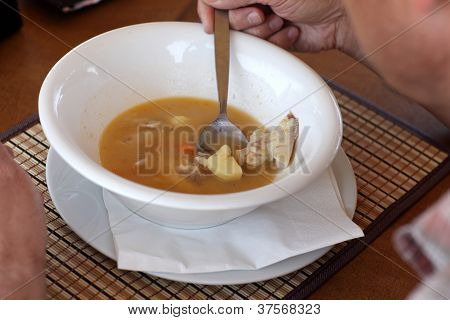 Man Eating Fish Soup
