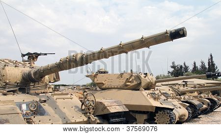 Old military tanks built abreast