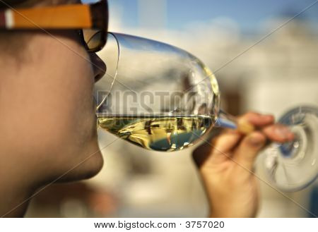 Woman Sipping A Glass Of White Wine