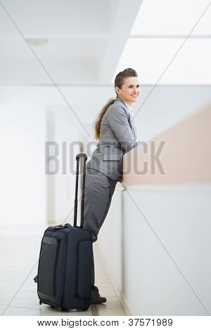 Business Woman In Business Trip With Wheel Bag
