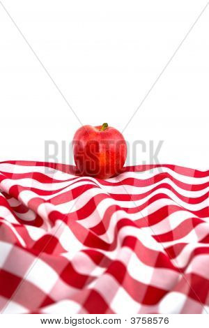 Red Gala Apple On Checkered Tablecloth