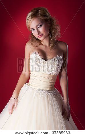 Fiancee In White Wedding Dress On Red Background Close Up