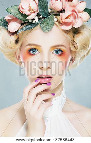Beautiful Blonde Supermodel In Wreath Of Flowers Studio Shot