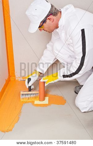 Plumber Applied Waterproofing Cuff Brush On The Floor Of The Bathroom Pipe Corner Aqueduct Channel