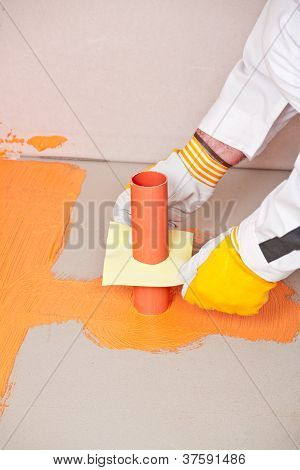 Plumber Builder Brush Applied Waterproofing On The Floor Of The Bathroom Pipe Corner Aqueduct Channe