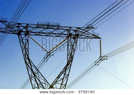Electric Power Lines Against Blue Clear Sky