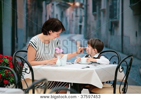 Mother and son having lunch together