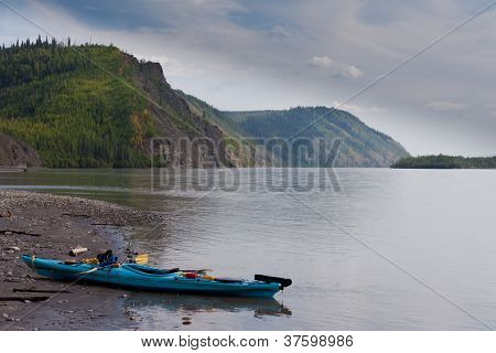 Kayak beached on the shore of Yukon River Canada