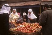 Veiled Arab Women Buy Apples In A Street Market