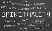 stock photo of universal sign  - Spirituality word cloud written on a chalkboard - JPG