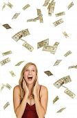 pic of happy-face  - Beautiful blond in red dress on white background with hundred and twenty dollars bills falling around her - JPG