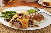 foto of beef wellington  - A gourmet beef wellington dinner with asparagus - JPG