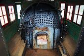 picture of loco  - Old train engine steam boiler that is old worn down and rusted - JPG