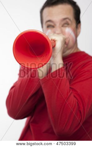 Man blowing vuvuzela