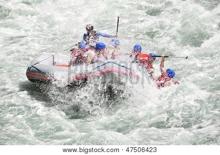 Rafting, splashing the white water