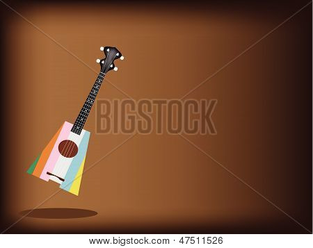 A Beautiful Ukulele Guitar On Dark Brown Background