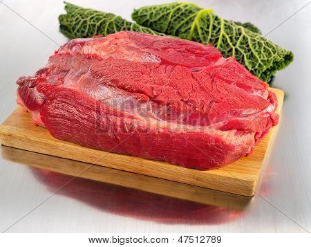 Raw Beef Flesh On Cutting Board