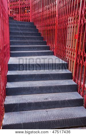 Black Staircase And Red Fence
