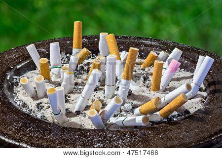 Cigarettes Butt In Ashtray