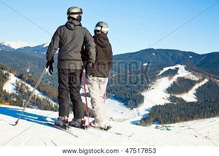Skiers overlooking ski slope at Bukovel ski resort