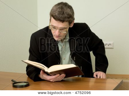 Guy In Eyeglasses Reads The Book