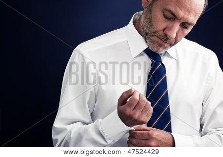 Senior Executive Businessman Gets Dressed Up