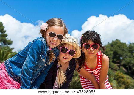 Three Girls Wearing Sunglasses.