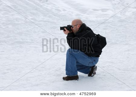 Photographer Shooting In Snow