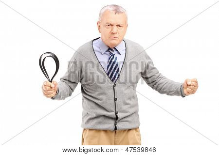Angry mature man holding a belt and posing isolated on white background