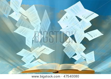 Papers Floating Or Flying From Open Book