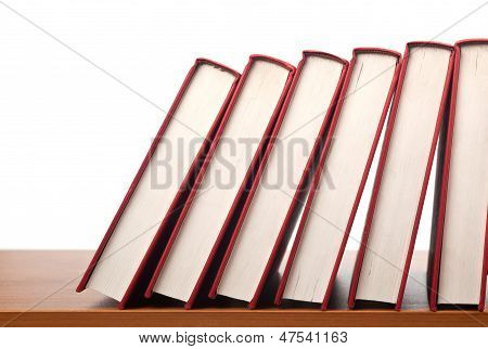 Row Of Books Falling In Sequence