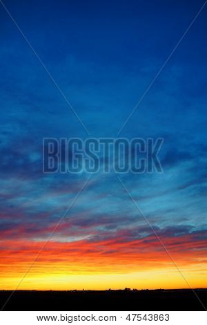 Vertical Colorful Sunset Over Land