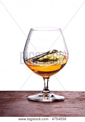 Glass With Brandy In Motion