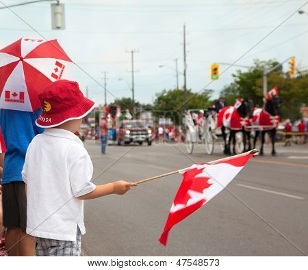 Boys Watching A Canada Day Parade. Aurora, Ontario, Canada.