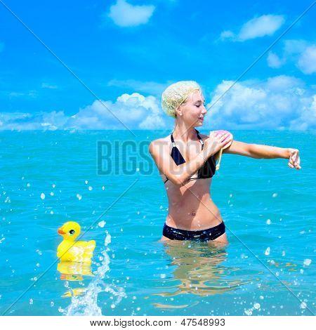 A Girl Takes A Bath In The Sea