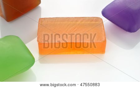 Few Colorful Glycerin Soaps On White.