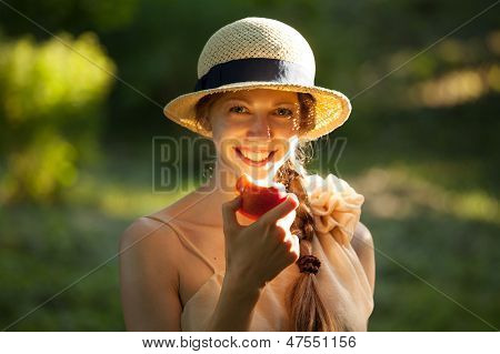 Happy Woman In Hat Eating Apple
