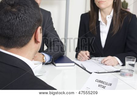 Man Explaining About Her Profile To Business Managers At A Job Interview