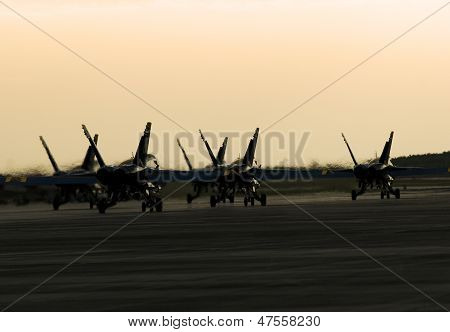 Silhouetted Jets on Ground