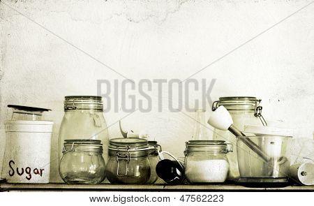Vintage photo of  kitchen utensils on wooden shelf