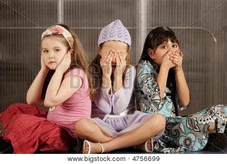 Three Kids Ignoring Evil