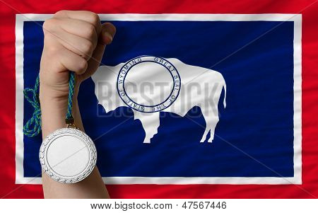 Silver Medal For Sport And  Flag Of American State Of Wyoming