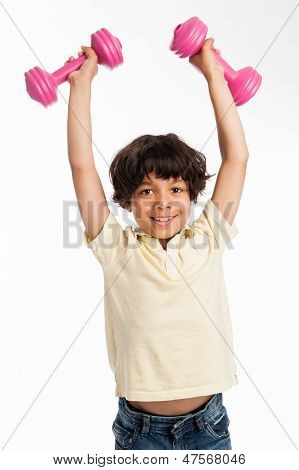 Cute Mixed Race Boy Lifting Weights