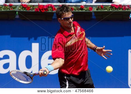 BARCELONA - APRIL, 23: Spanish tennis player Tommy Robredo in action during a match of Barcelona tennis tournament Conde de Godo on April 23, 2013 in Barcelona
