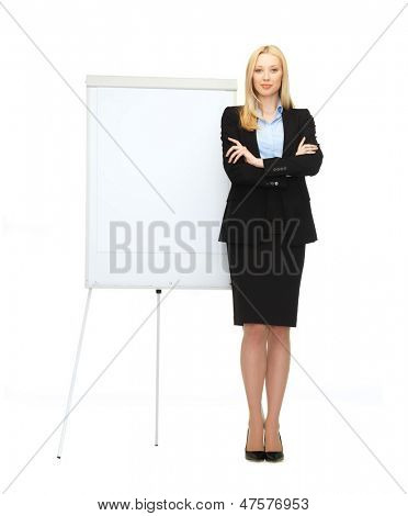 bussiness and education - businesswoman with flipchart in office