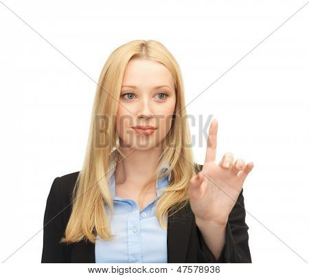 beautiful young businesswoman working with something imaginary