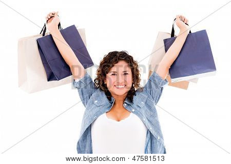 Very happy shopping woman with arms up - isolated over white background